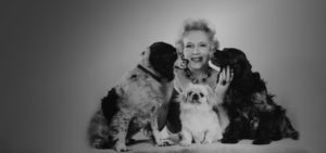 Barbara Cartland with her dogs
